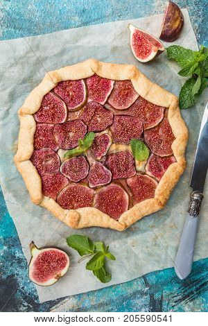 Homemade figs galette made with fresh organic figs on stone background, top view