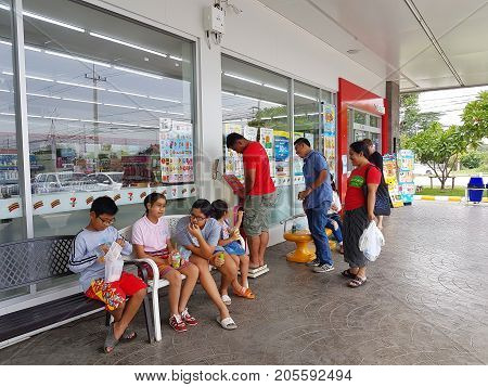 CHIANG RAI THAILAND - MAY 7 : unidentified asian people or tourists sitting and standing in front of 7-eleven shop on May 7 2017 in Chiang rai Thailand.