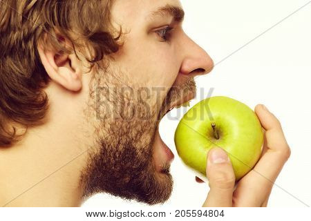 Guy Trying To Bite Big Green Apple Looking At It