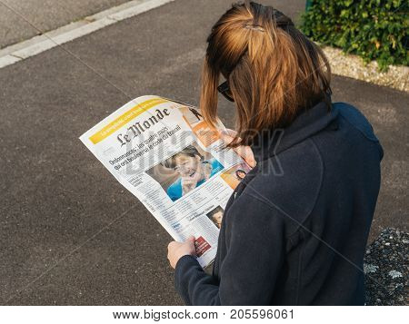 Woman Reading Le Monde French Press Angela Merkel Elections Germany