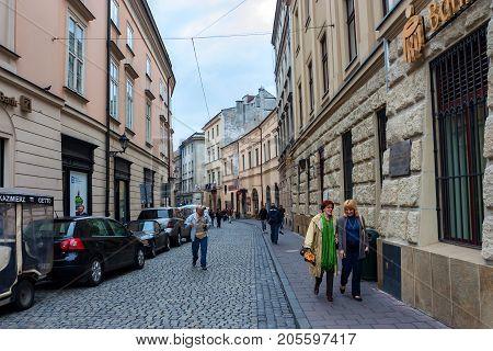 KRAKOW, POLAND - JUNE, 2012: Beautiful historic street of Krakow, popular tourist city in Poland