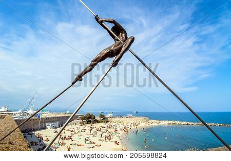 Antibes France - July 01 2016: day view of modern sculptures and Plage de la Gravette beach in Antibes.