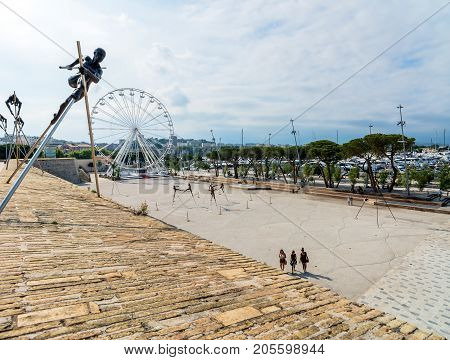 Antibes, France - July 01, 2016: Modern art sculptures on the Pre-des-Pecheurs esplanade in the old town. The area was renovated in 2014 and is popular for events.