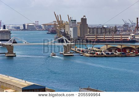 BARCELONA SPAIN - AUGUST 27 2012: Terminal Port Nou Сontainer ship in import export and business logistic By crane Trade Port Ship cargo to harbor Barcelona. Catalonia Spain.