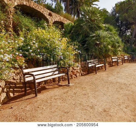 Stone walkway in the Park Guell in Barcelona. Catalonia Spain. Vintage retro style