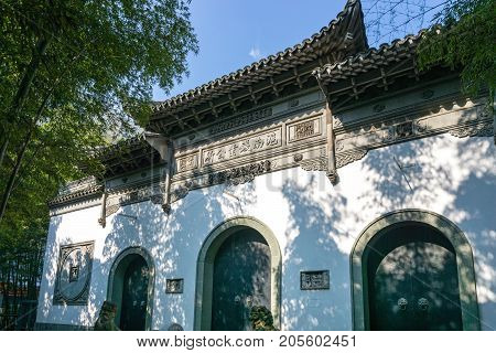 Shanghai, China - Nov 4, 2016: Gucheng Park (Northeast Gate) - Three-arch gate build in traditional Chinese architectural style. This area is usually shaded by nearby tall bamboo trees.