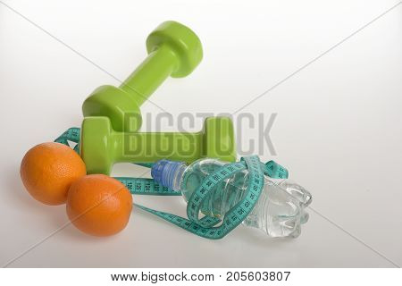 Sports And Healthy Regime, Copy Space. Dumbbells In Green Color