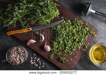 Preparation of pesto from carrot leaves, garlic, sunflower seeds horizontal
