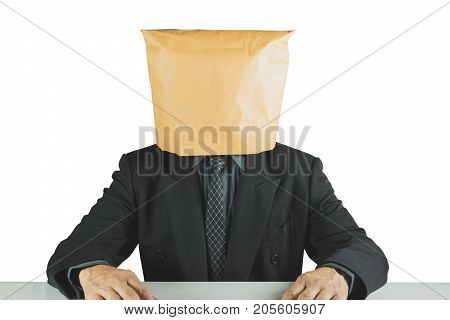 Businessman wearing brown paper bag isolated on white background. Businessman with a paper bag on head.