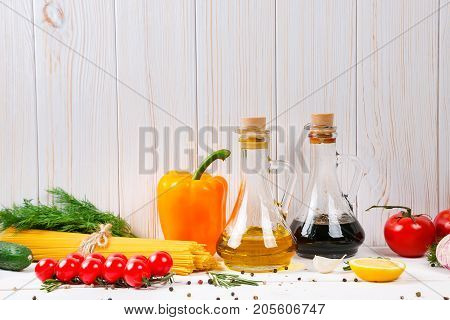 Spaghetti, Tomatoes Cherry, Olive Oil, Herb And Spices On Old White Wooden Background. Set For Healt