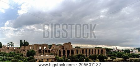 Archaeological Ruins Of The Severian Arcades On The Palatine And Temple Of Apollo Palatine With A Sk
