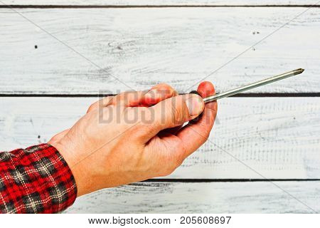 Male Hand With A Screwdriver, Handyman Concept