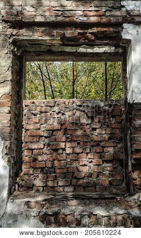 Old window in a ruined house. Old architecture.Old window. Historic arhitecture. Destroyed house.