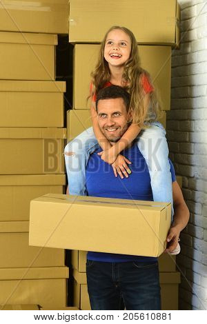 Girl And Man With Happy Smiling Faces In Room