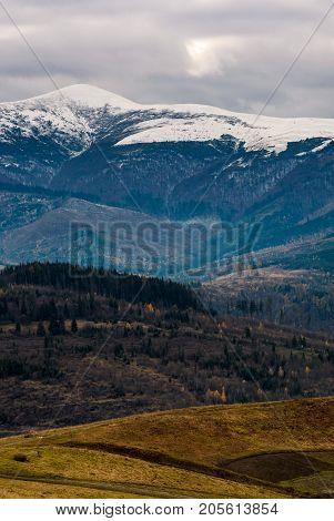 Snowy Mountain Ridge In Late Autumn