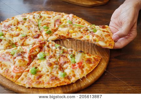 Hands Taking Slices Of Italian Pizza.