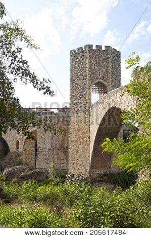 Bridge And A Tower Made Of Stone Over A River, Spain