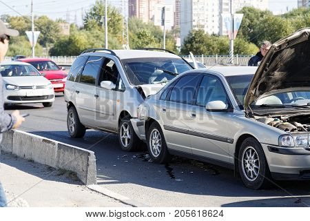 Two Cars In A Car Accident On Street