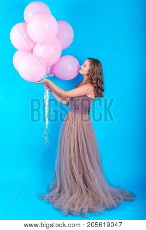 Beautiful Young Woman Having Fun With Pink Helium Air Balloons Over Blue Background, Full Length Bod