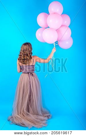 Beautiful Young Woman Having Fun With Pink Helium Air Balloons On Blue Background, Full Length Body.
