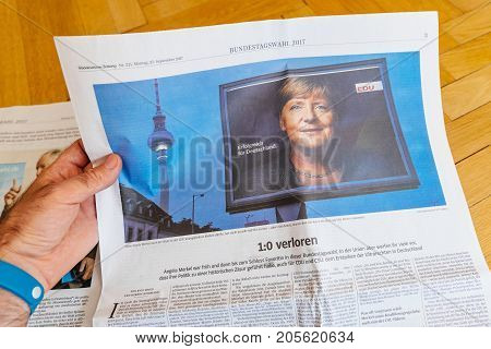 PARIS FRANCE - SEP 25 2017: suddeutsche zeitung newspaper with portrait of Angela Merkel after election in Germany for the Chancellor of Germany the head of the federal government
