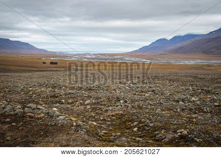 Scenic view of arctic landscape in Svalbard Norway. Adventdalen (Advent valley) Adventfjorden (Advent fjord) and Longyerbyen in background