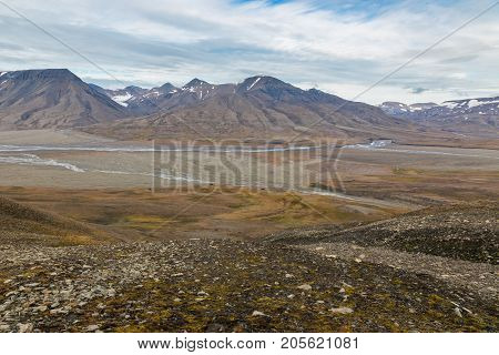 Scenic view of Adventdalen (Advent valley) and Adventelva (Advent river) in Svalbard Norway. End of summer season.