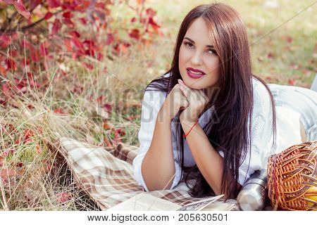 Autumn Portrait Of A Beautiful Young Woman. Happy Young Woman Walking In Autumn Park. Young Woman Re