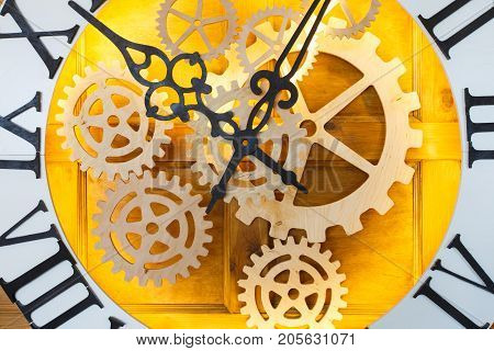Huge fairy like clock with watch mechanism. Magical golden clock dial closeup