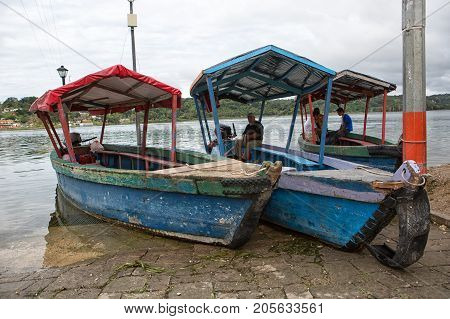 January 11 2015 Flores Guatemala: taxi boat waiting for customers on the shore of the popular tourist destination island