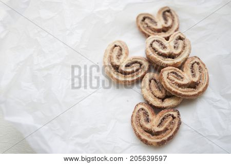 Puff pastry with cinnamon and sugar in the form of hearts