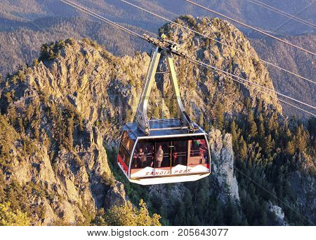 ALBUQUERQUE, NEW MEXICO, JUNE 18. The Sandia Peak Aerial Tramway Observation Deck on June 18, 2017, in Albuquerque, New Mexico. A Sandia Peak Aerial Tramway Uphill Tramcar Seen from the Observation Deck in Albuquerque New Mexico.