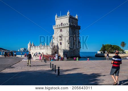 LISBON PORTUGAL - SEPTEMBER 13 . 2017 . Torre de Belem UNESCO World Heritage View from Across Park During Sunny Day