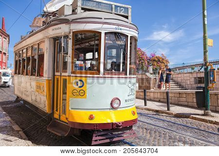 LISBON PORTUGAL - SEPTEMBER 14 . 2017 . Vintage tram in the city center of Lisbon Lisbon Portugal in a summer day