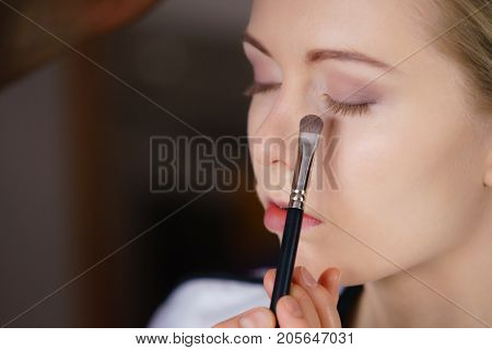 Woman Getting Make Up Done By Artist
