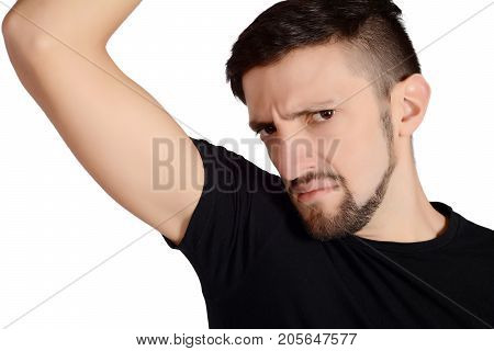 Man Smelling His Armpit.