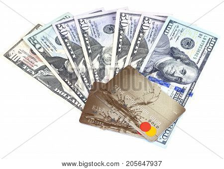 Dollars and two gold bank cards on a white background