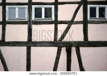 The beam construction and the timber frame of a half-timbered house.