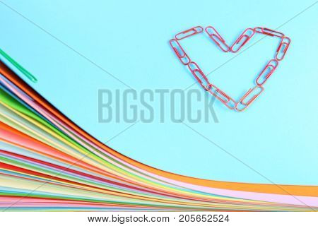 Stack of colored papers with the paperclips