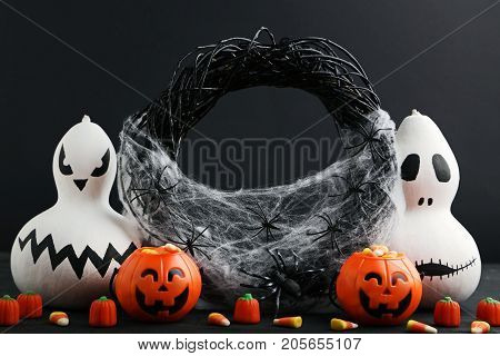 Halloween Candy Corns With Pumpkins And Spiders On Wooden Table