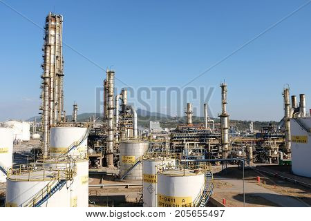 Oil Refinery View With Cranes And Various Equipment
