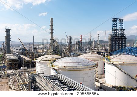 Oil Refinery Construction Site View With Cranes And Various Equipment