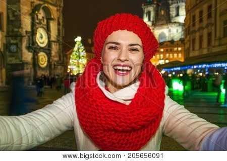 Woman At Christmas In Prague Czech Republic Taking Selfie