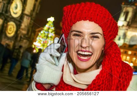 Tourist Woman At Christmas In Prague Speaking On Smartphone