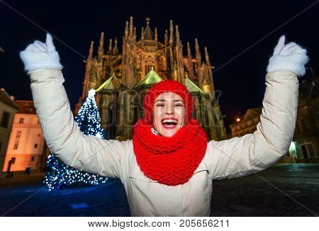 Woman Against St. Vitus Cathedral In Christmas Prague Rejoicing