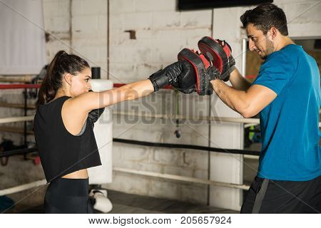Boxer Training With Her Coach