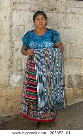January 20, 2015 San Pedro La Laguna, Guatemala: Indigenous Woman Presenting Traditional Wear Of The
