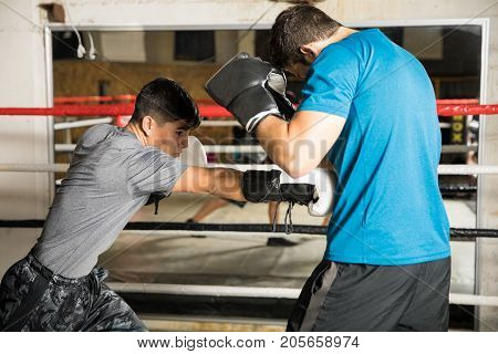 Shorter Boxer Beating A Bigger Man