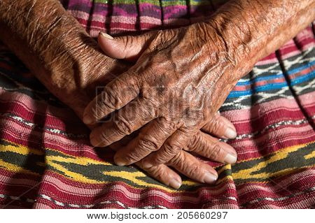 January 26, 2015 San Pedro La Laguna: Hands Of A Very Old Tzutujil Maya Woman In The Small Indigenou