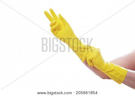 a maid putting on rubber gloves to clean.